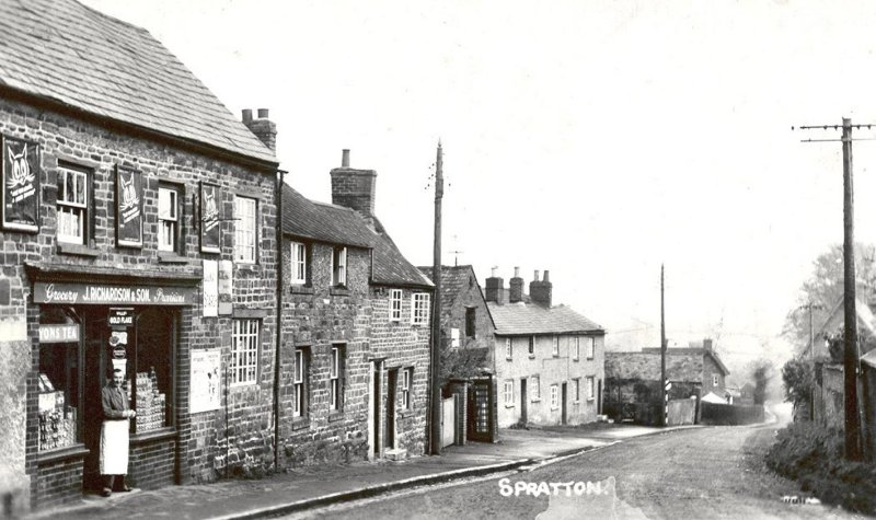The grocery store in Station Road, Spratton, owned by John Richardson. The sign above the store reads 'J Richardson & Son'