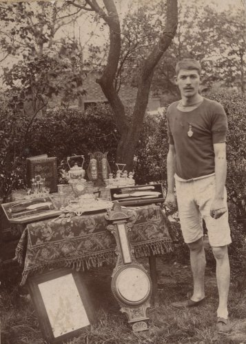 William Whatton with his athletic trophies in the early 1900s
